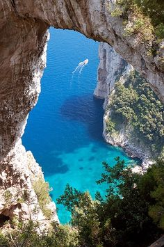 Isle of Capri-Italy. How much I love this place. Natural arches everywhere in the rocks.
