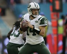 New York Jets' Ryan Fitzpatrick, right, prepares to pass the ball during the NFL football game between the New York Jets and the Miami Dolphins and at Wembley stadium in London, Sunday, Oct. 4, 2015. (AP Photo | Tim Ireland)