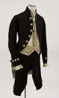 Black wool broadcloth court presentation suit trimmed with steel cut buttons and worn with an off-white silk embroidered vest. This ensemble was worn by Thomas Alexander Biddle: a prominent Philadelphian presented at the court of King William IV in 1837. 2007.029 a-g. | UD Department of Fashion and Apparel Studies