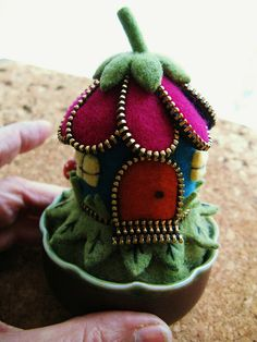I love her work...she combines felted sweaters and zippers and makes something magical like this!