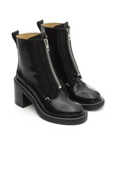 """Italian calf leather ankle boot with military center zipUpper made from Italian calf leather3 3/8"""" Wooden heel, wrapped in stacked leatherLeather soleFront metal zipper closure"""