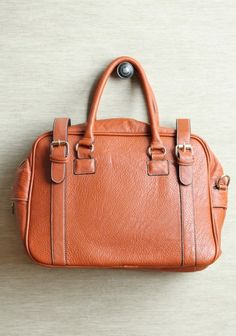 9f45ac9b06 working girl leather purse  53.99 This faux leather purse in cognac  features a large interior compartment