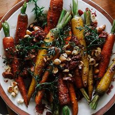 Whole roasted carrots make quite a statement on the dinner table when they're topped with a port wine-and-fig dressing. In this recipe, we like dried Calimyrna figs because they're a tad less sweet than Mission figs and taste slightly nutty as well.
