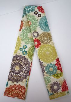 I want to make this!  How fun... a camera strap cover.