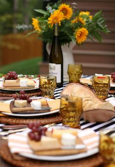 Use sunflowers and striped linens to DIY this Thanksgiving table.