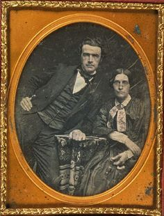 ca. 1840-60, a gentleman leaning dramatically across a table, with a woman sitting politely beside him