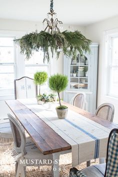 Miss Mustard Seed: love the table runner, and the arrangement of rushes in the corner cabinet.