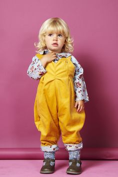 These childrens dungarees for girls aged newborn to 4 years old are handmade and created in a vibrant autumn mustard yellow, fine needle corduroy fabric, with a contrasting floral turn-up.  Double buttoned on the strap for extra length, the girls dungarees also feature two side buttons to make changing nappies easier.   http://www.whatmothermade.co.uk/girls-clothes-what-mother-made/girls-pleated-dungaree-in-fine-mustard-needle-cord-and-blue-floral-trim