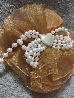 Beautiful hand made shimmer gold, stacked chiffon hair bow with layers of sparkly gold chiffon. This exquisite hair clip has a pearl colored heart and beaded pearl bow in the center. This truly one of a kind bow is Approximately Gold Hair Bow, Hair Bows, Heavenly, Hair Clips, Unique Jewelry, Handmade Gifts, Pearls, Etsy, Vintage