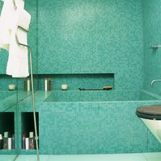 turquoise tiles are so pretty and relaxing!   10 Amazing Bathroom Tiles