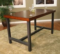 American Heritage Kingston Counter Height Dining Table by Universal Lighting and Decor. $399.95. Dimensions: 60L x 42W x 36H inches. Two-tone chestnut and black finish. Wooden tabletop with sturdy steel base. Modern architectural design. Comfortably seats 4. With a chestnut finish solid wood and maple veneer table top, this counter height dining table has a warm, contemporary look. The base is crafted from solid steel and comes in a black finish. Some assembly required. From A...