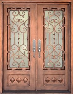 """Victorian """"New Orleans"""" style Iron Double Door. Hand forged wrought iron grille on wrought iron door. Deep bronze finish."""
