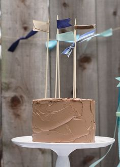 Loved this....how cute and simple!  skewers with ribbon on cake with a cute ribbon pennant in the background