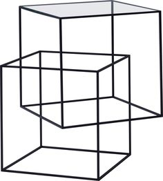 """Nento 2011 - A delicate yet striking creation: a low geometrical table created by the intersection of two offset cubes, whose upper """"L"""" shaped profile supports an extra-light glass table top. The iron structure, coated with matt black powder epoxy, creates a series of joints and transparencies reminiscent of Escher's maze designs."""