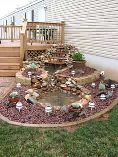 Another lovely pond idea for the back of your house using pebbles and bricks. The online videos can help you with the detailed tutorials.