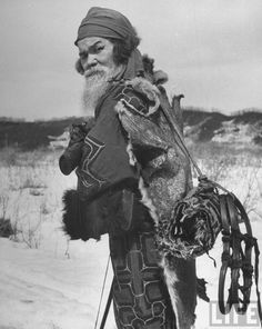 Ainu village chief: a dog skin protects his back from biting cold, Shiraoi, 1946 by Alfred Eisenstaedt