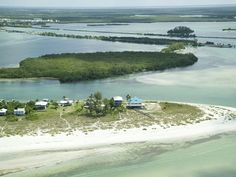 This Modern Gulf To Bay Home Is Located At The Tip Of Little Gasparilla Island.Vacation Rental in Little Gasparilla Island from Little Gasparilla Island, Boat Dock, Home And Away, Ideal Home, Explore, Places, Water, Travel, Outdoor
