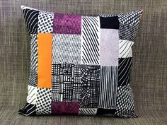 Think I'll try this with the blues and greens.  www.discountdesignercushions.com