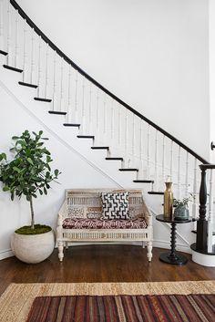 black bannister, white walls