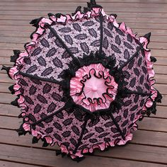 Pink parasol with black lace overlay