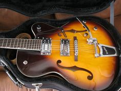 Gretsch G5120 guitar with hard case and leather strap