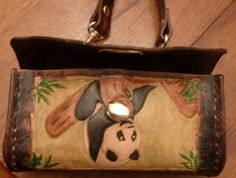 The front of the panda purse when it is open