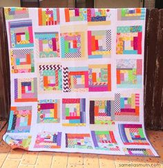 Scrapalicious Improv Quilt--Posted by Anorina (Samelias Mum)... I made my first, truly improvised, quilt.  My scrap tub was overflowing, so I tipped it out over my sewing space and began sorting the fabric into sizes. I began all of my blocks with the same fabric...