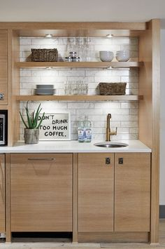 Outfitted with a microwave, fridge and dishwasher, the kitchenette — formerly the minibar — is always stocked with snacking staples. Cozy Basement, Modern Basement, Basement Makeover, Basement House, Basement Renovations, Basement Apartment, Basement Finishing, Basement Ideas, Petite Kitchenette