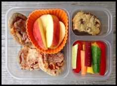 This is what my girls got for lunch today: Mini pita pizzas (defrosted), apple slices, veggie mix (multi-colored carrots, red bell pepper, cucumber), and for a rare treat - a homemade whole-wheat chocolate chip cookie. TGIF! smile emoticon