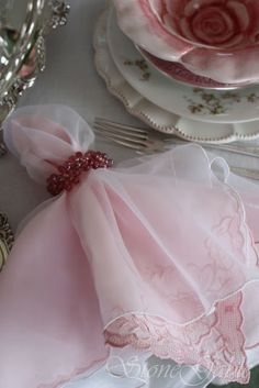 Delicate table linens and a formal table set for a holiday family dinner!