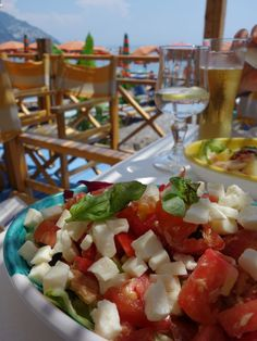 In Positano caponata has nothing to do with eggplant. Instead, it's a heavenly mash up of Panzanella and Insalata Caprese. I got a recipe from a beach side restaurant at Fornillo beach in Positano.