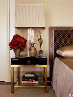 A Karl Springer acrylic-and-brass lamp rests on a Jansen side table in the master bedroom. The sculpture is by André Arbus.