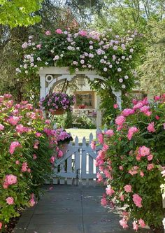 english garden oh how beautiful is this old English cottage garden with its white picket fence and trellis burgeoning with all things pink!