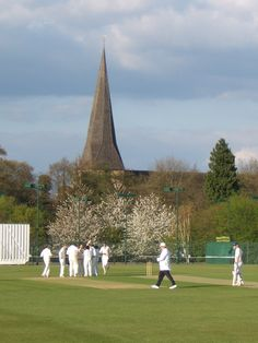Horsham Cricket Ground    A wicket falls in the first League game of the season. The umpire moves to his position for the next over.  The church is St Mary's - old - built in the thirteenth century