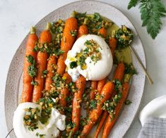 Roasted carrots topped with creamy burrata and a citrus-salty carrot top and preserved meyer lemon pistou is a deliciously bright plate perfect for spring. Roasted Okra, Roasted Carrots, Fall Dishes, Summer Side Dishes, Veggie Dishes, Vegetable Recipes, Ham Hock Soup, Whole Beef Tenderloin, Cooking