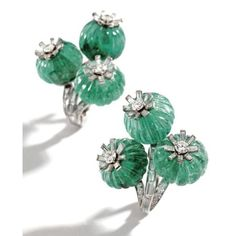 Pair of Platinum, Fluted Emerald Bead and Diamond Earclips, Cartier, London, Circa 1930. Photo Sotheby's Designed as flowers set with fluted emerald beads, accented by round and baguette diamonds weighing approximately 2.50 carats, signed Cartier, London.