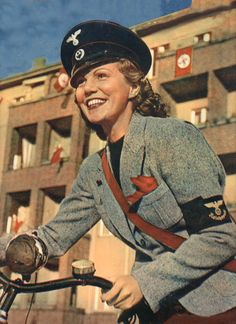 Woman of the Reich  Great Pictures in attached site! Vintage looking WW2 picture  http://www.vantiques.nl