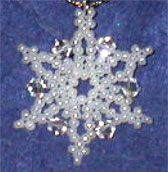 Seed Bead & Crystal Snowflakes by Sandra D. Halpenny.  These delicate 1¼ inch snowflakes are so much fun to stitch you'll make a blizzard of them! Perfect for seasonal teacher or hostess gifts, ornaments, window decorations, gift tags and more!