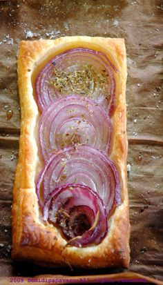 Red Onion Tart, looks easy with frozen puff pastry. Would need to do something to get the onions to caramelize a bit, though.