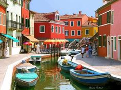 If you ever visit Venice, visit a small island called Burano for a day. Beautiful with rich colorful buildings, and awesome food.