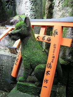 Kitsune Statues at the Fushimi Inari Shrine in Kyoto.