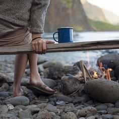 bench, beach, enamel cup and fire.