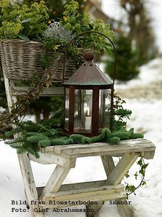 A charming chair and a lantern vignette by the front door for the Christmas season!  So pretty!