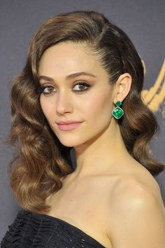 A deep side part is elegant on its own, but Emmy Rossum's version, seen at the Primetime Emmy Awards, featured an extra dose of allure. With hair combed back behind one ear like hers, you can put your wedding earrings on full display. Daily Hairstyles, Trending Hairstyles, Celebrity Hairstyles, Down Hairstyles, Prom Hairstyles, Curly Hair Tips, Curly Hair Styles, Celebrity Wedding Hair, Bridesmaid Hair Half Up
