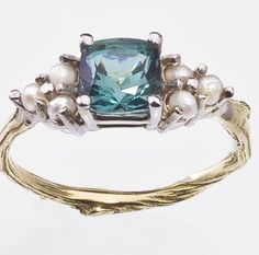 Oceanic ring -- driftwood style band, pearls, and teal sapphire. <3  An absolute favorite as far a non-diamond engagement rings go. Pearl Ring for Engagement or not Antique Style Gold Twig by bmjnyc, $1810.00