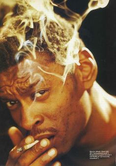 Daddy G with spliff in tow. Photo originally taken from Massive Attack's interview with Mojo Magazine in July 1998.