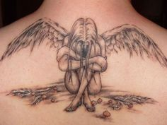 Fallen Angel Tattoo. So close to what I'm looking for but its not the same.
