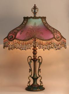 Antique era metal lamp base and hand-dyed Turkish Starling silk lampshade of gold metallic net with turquoise swirls, Nouveau/Egyptian style gold embroidered netting, Victorian era chenille and metallic trim. It is a wonder. Victorian Lamps, Victorian Furniture, Antique Lamps, Antique Lighting, Vintage Lamps, Victorian Era, Victorian Lighting, Vintage Furniture, Chandeliers