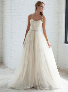 Tara LaTour Fall 2016 white strapless tulle overskirt wedding dress | https://www.theknot.com/content/tara-latour-wedding-dresses-bridal-fashion-week-fall-2016