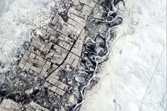 .People need straight lines, the nature of this is generated. Dynamic river and ordered farms, Central Asia